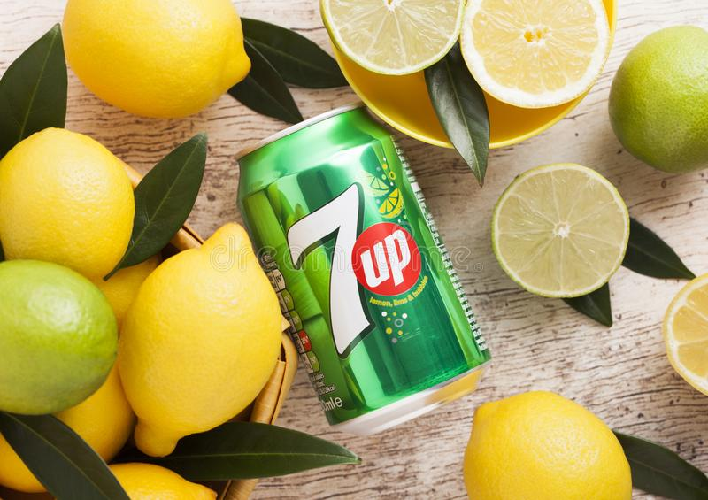LONDON, UK - APRIL 27, 2018: Aluminium can of 7UP lemonade soda drink with fresh lemons and limes on wooden background.Top view. LONDON, UK - APRIL 27, 2018 stock photos