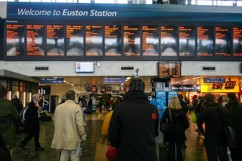 Rush hour at London Euston train station. LONDON, UK - APRIL 20, 2012 : busy morning with crowd people at London Euston train station royalty free stock photography