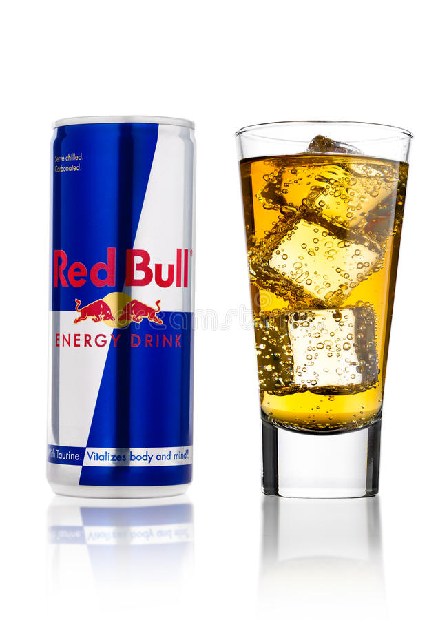 LONDON, UK - APRIL 12, 2017: Can of Red Bull Energy Drink with glass and ice cubes on white background. Red Bull is the most popul. LONDON, UK - APRIL 12, 2017 royalty free stock photography
