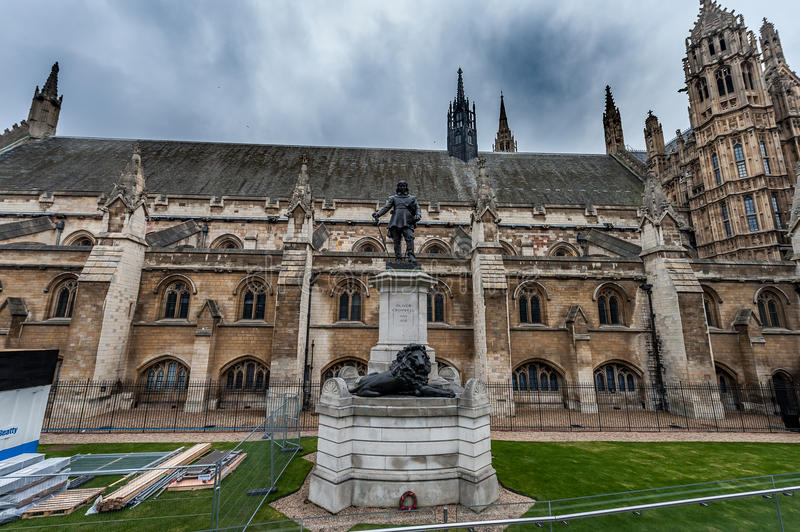 LONDON, UK - APRIL 9, 2013: One Side of British Parliament And Oliver Cromwell Statue with construction fence stock images