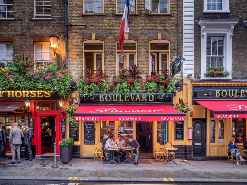 London pubs and restaurants. LONDON UK - AUG 2: London pubs and restaurants in the Covent Garden area on August 2, 2017 in London England. London has many stock photos