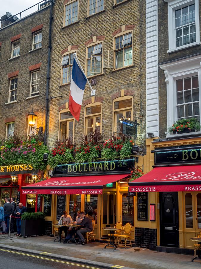 London pubs and restaurants. LONDON UK - AUG 2: London pubs and restaurants in the Covent Garden area on August 2, 2017 in London England. London has many stock image
