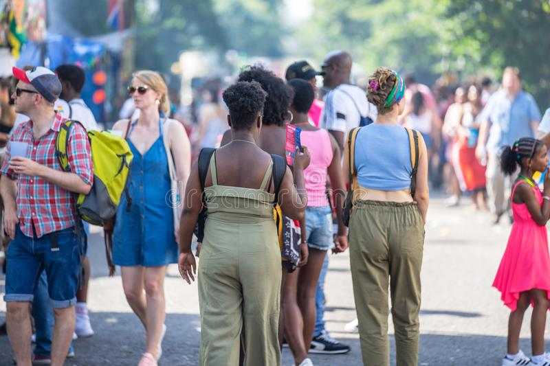 London, UK ,August 25, 2019.Caribbean colour comes to west London as Notting Hill Carnival gets into full swing with hundreds of. Thousands joining the throng royalty free stock photo