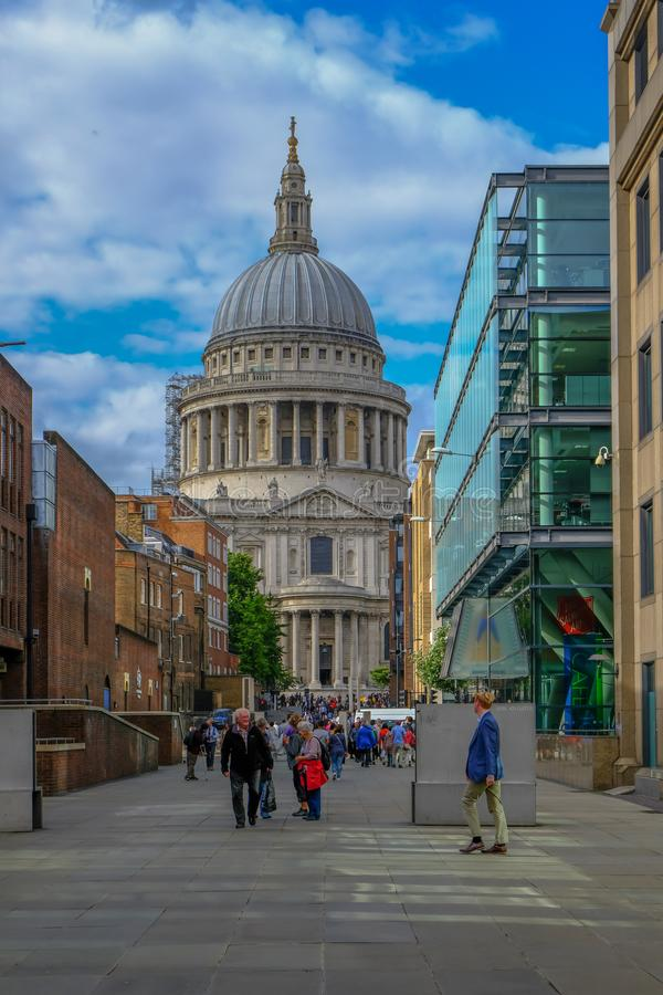 London, UK - August 3, 2017: Looking towards St. Paul's Cathedral from the Millennium. Bridge. Shows lots of people walking on the pathway linking up to the stock images