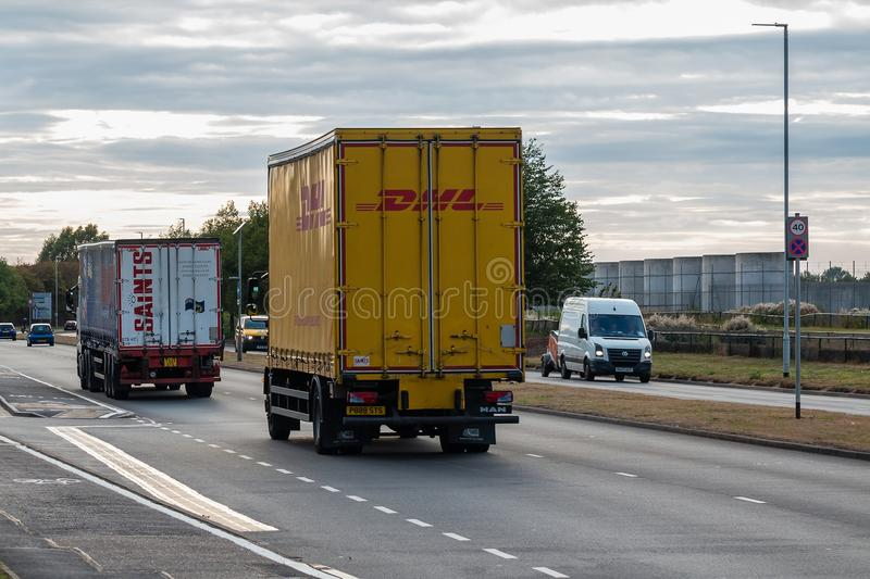 DHL lorry in motion on the road stock images
