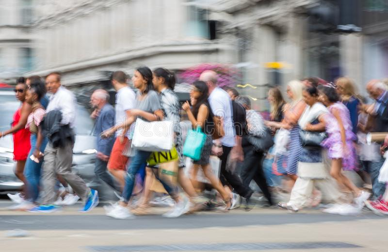 London, UK. Lots of walking people, tourist and Londoners, crossing the Piccadilly circus junction. stock photography