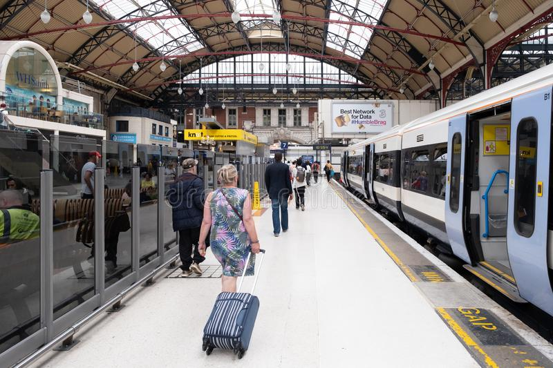 Passengers and trains at London Victoria Station stock photo