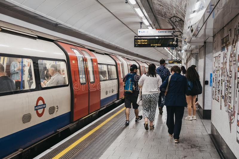 People walking on Tottenham Court Road London Underground station platform, motion blur, selective focus. London, UK - August 31, 2019:People walking on royalty free stock image