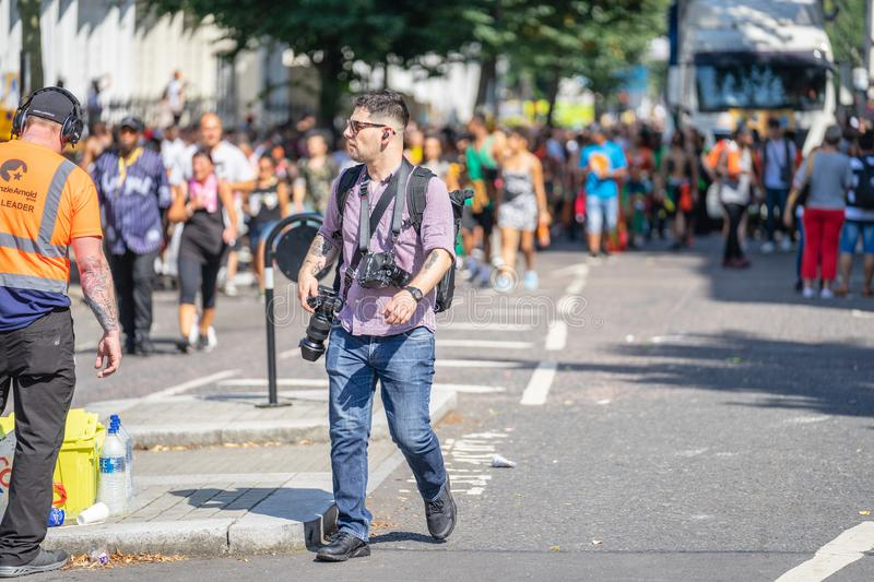 London, UK ,August 25, 2019. Professional photographer working at notting hill carnival. London, UK ,August 25, 2019 Professional photographer working at notting stock photos