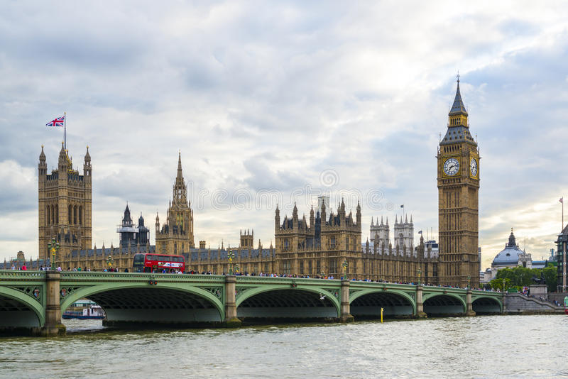 LONDON, UK - AUGUST 12: Side view of busy Westminster Bridge over the Thames with Houses of Parliament and Big Ben in stock photos