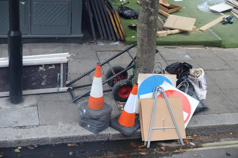 Street cones and signs left on the street. London, UK - August 27, 2018: Street cones and signs left on the street stock images