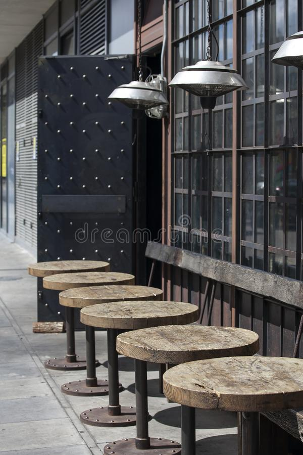 tables outside at the urban cafe with modern lamps in the art