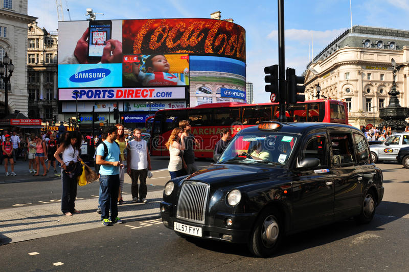 London. UK - 9 August, 2012:  taxi in Piccadilly Circus, major commercial area of , home of important landmarks and shops stock photo