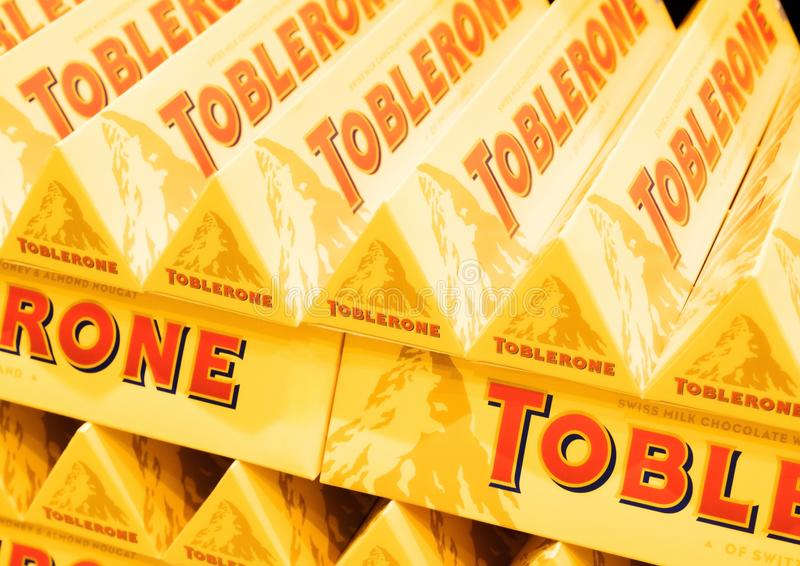 LONDON, UK - AUGUST 31, 2018: Tubes of Toblerone chocolate in grocery store with logo. Close up royalty free stock photography