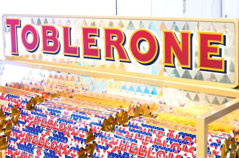 LONDON, UK - AUGUST 31, 2018: Tubes of Toblerone chocolate in grocery store with logo on display. Close up royalty free stock photo