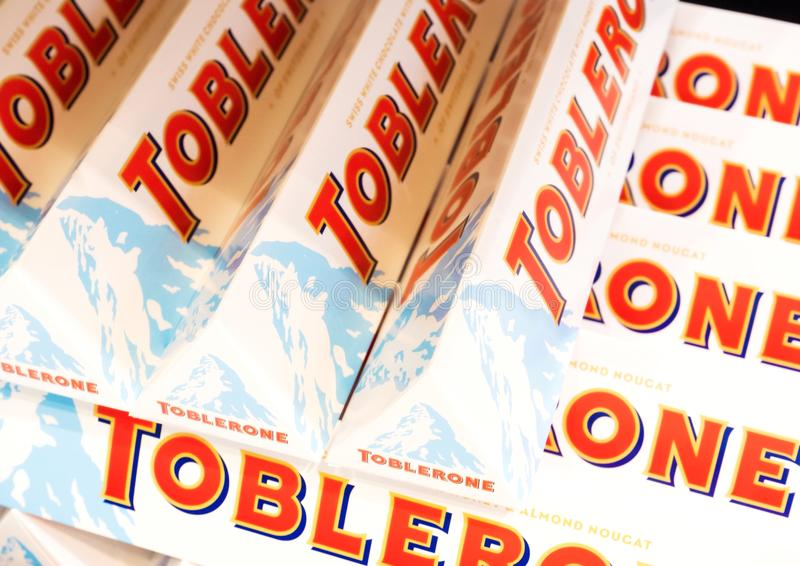 LONDON, UK - AUGUST 31, 2018: Tubes of Toblerone white chocolate in grocery store with logo. Close up royalty free stock photo