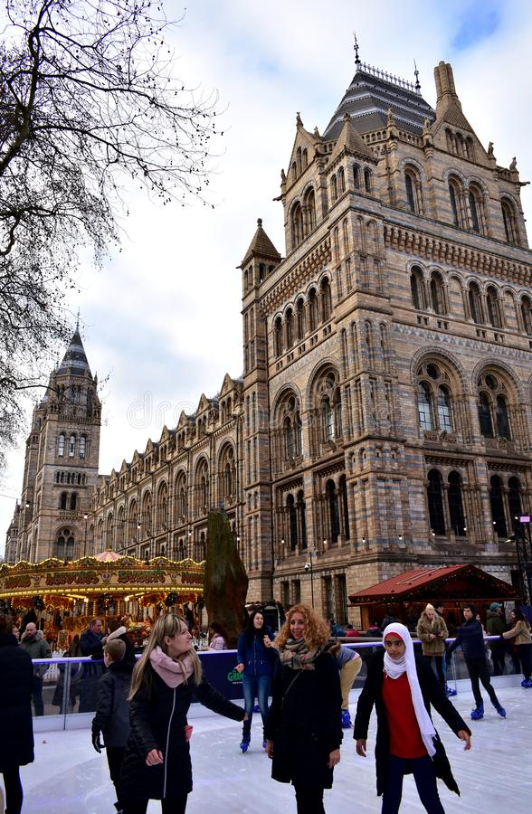 People skating on ice at the Natural History Museum Christmas Ice Rink. London, United Kingdom, January 2019. stock photo