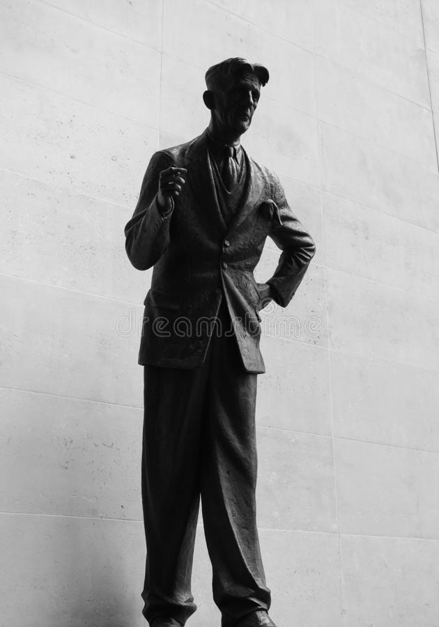 Orwell statue at BBC Broadcasting House in London, black and whi. LONDON, UK - CIRCA SEPTEMBER 2019: George Orwell in front of BBC Broadcasting House in Portland stock photography