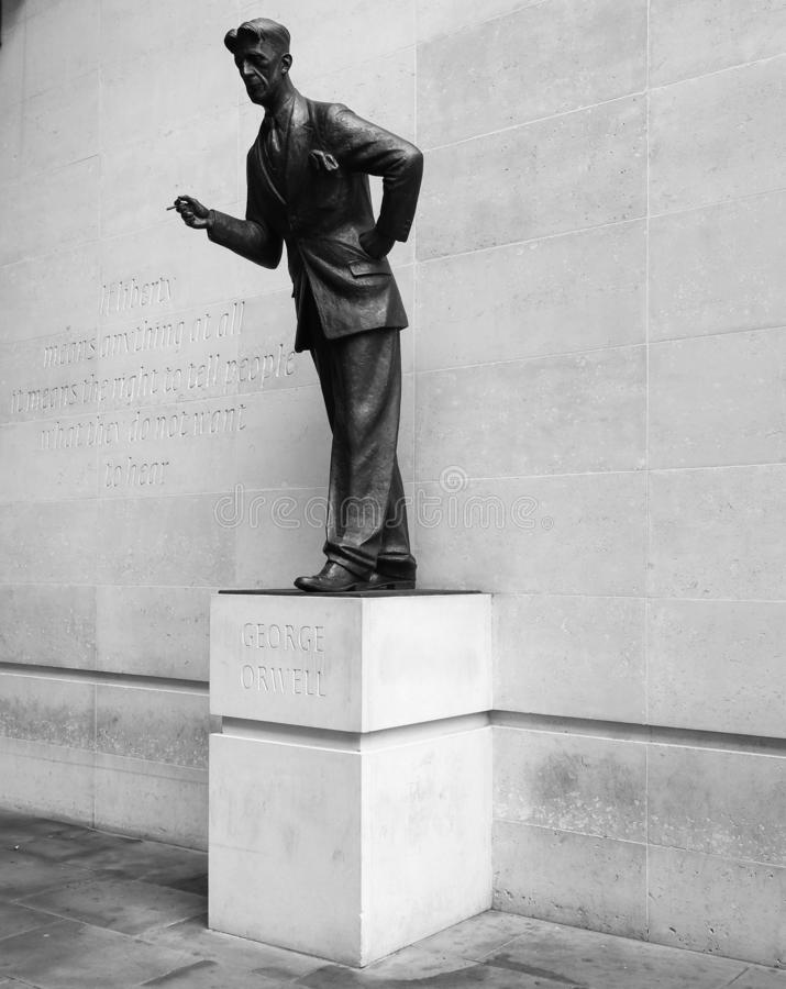 Orwell statue at BBC Broadcasting House in London, black and whi. LONDON, UK - CIRCA SEPTEMBER 2019: George Orwell in front of BBC Broadcasting House in Portland stock images