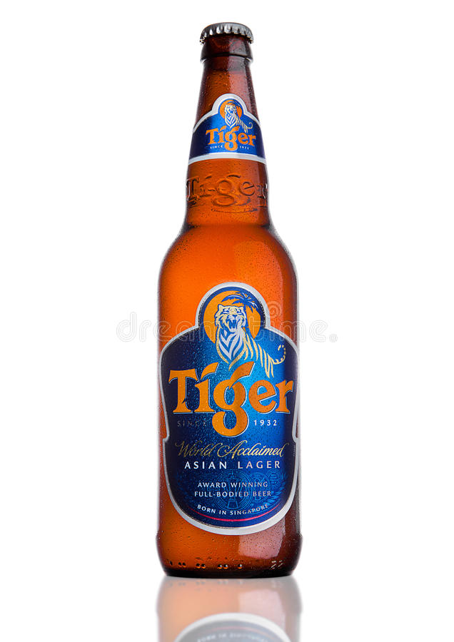LONDON, UK, DECEMBER 15, 2016: Bottle of Tiger Beer on white background, First launched in 1932 is Singapore`s first brewed beer. royalty free stock images