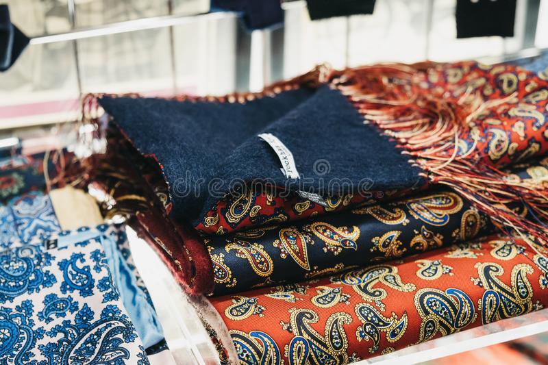 Stack of paisley scarves on the window display of Peckham Rye shop in Covent Garden, London, UK stock photos