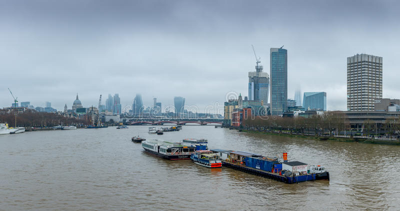 London, UK - December 13, 2016: London skyline as seen from Waterloo bridge. On a foggy and cloudy morning royalty free stock images