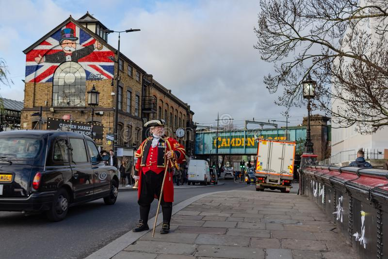 London, UK - 20, December 2018: Man in 18th century British army infantry redcoat uniform walking in Camden Town, UK stock photography