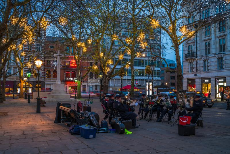 Salvation Army brass band plays music on Duke of York Square in royalty free stock photo