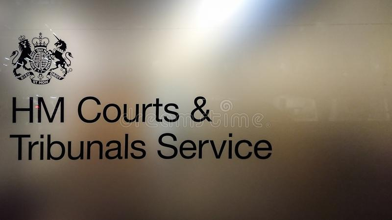 HM Courts & Tribunals Service. LONDON, UK - 11 DECEMBER 2017: The sign, logo and coat of arms for the HM Courts and Tribunals Service, an executive agency of the royalty free stock photography
