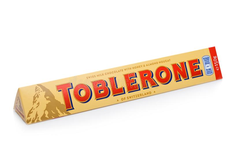 LONDON, UK -DECEMBER 07, 2017: Toblerone Swiss Milk Chocolate with Honey and Almond Nougat on white. Toblerone is a Swiss chocolat. LONDON, UK -DECEMBER 07, 2017 royalty free stock photography