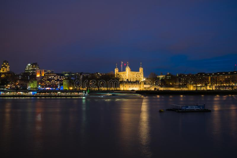 View of Tower of London across River Thames, London UK royalty free stock photos