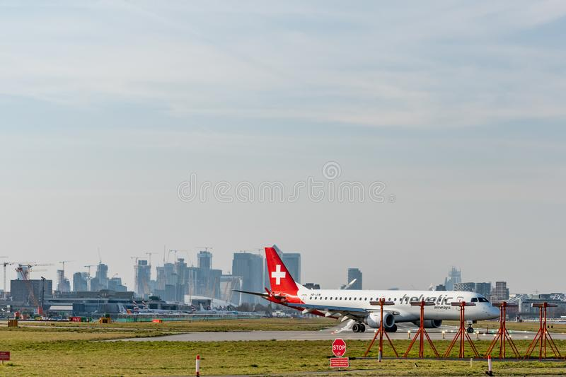 London, UK - 17, February 2019: Helvetic Airways airline based in Zurich Kloten, Switzerland. Aircraft type Embraer ERJ-190 at. London City Airport royalty free stock photos