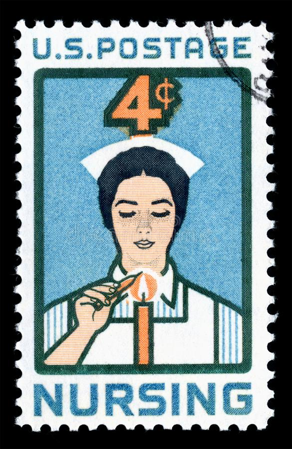 United States of America cancelled postage stamp showing an image of a Nurse lighting Candle of Dedication stock images