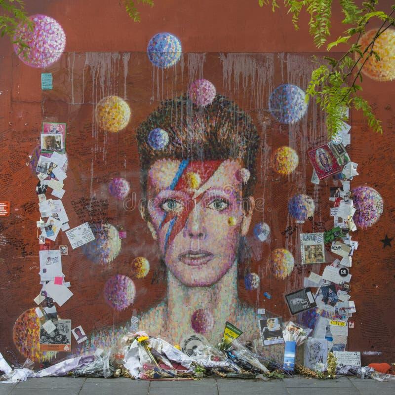 LONDON, UK - Graffiti of David Bowie as Ziggy Stardust in Brixton, London. A graffiti of David Bowie as Ziggy Stardust in Brixton, London Since his death the stock image