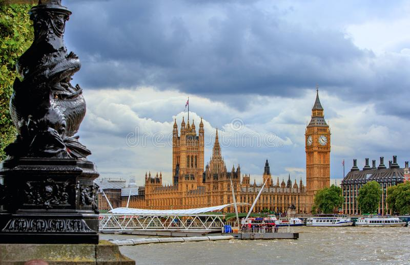 Houses of parliament as seen from the south bank with tourist boats in the foreground, London, 2015 royalty free stock images