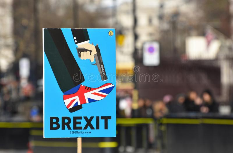 Anti Brexit Sign In London, UK Jan 2019. London, UK, January 17 2019. Anti Brexit / Pro Remain in EU sign showing Britain shooting itself in the foot outside the royalty free stock photo