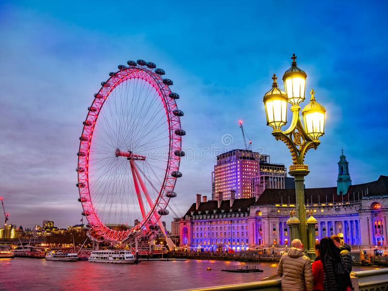 Famous wheel of London, the big Eye in evening lights stock photos