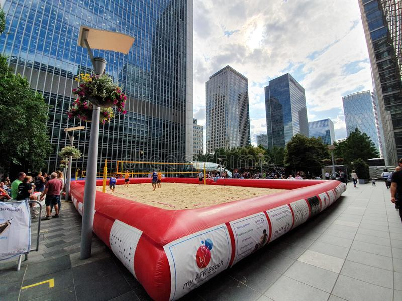 London UK - July 2019: Beach volleyball court established near business centers at the center of Canary Wharf, London stock images