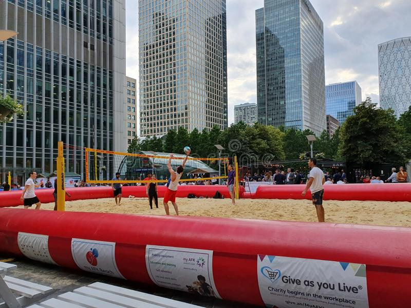 London UK - July 2019: Beach volleyball court established near business centers at the center of Canary Wharf, London stock photo