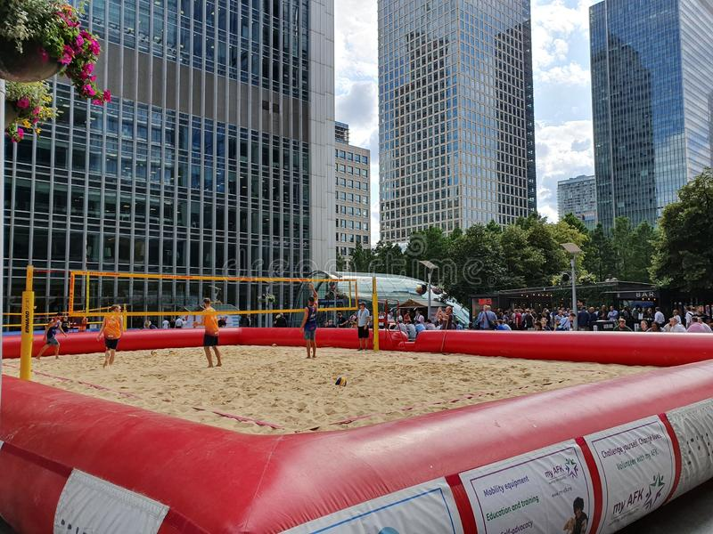 London UK - July 2019: Beach volleyball court established near business centers at the center of Canary Wharf, London royalty free stock images
