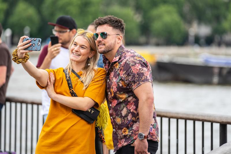 London, UK, July, 2019. Close up portrait of happy attractive couple taking selfie in London stock photo