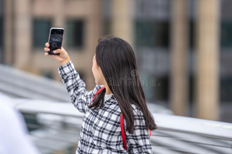 London, UK, July, 2019. Close up portrait of happy attractive girl taking selfie in London stock photography