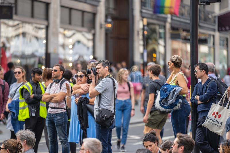 London, UK, July 14, 2019. Landscape and cityscape photographer taking pictures of free public event.  stock images