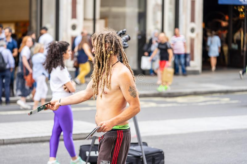 London, UK, July 14, 2019. Leaflet Distributor or Flyer Distributor. Regent Street royalty free stock images