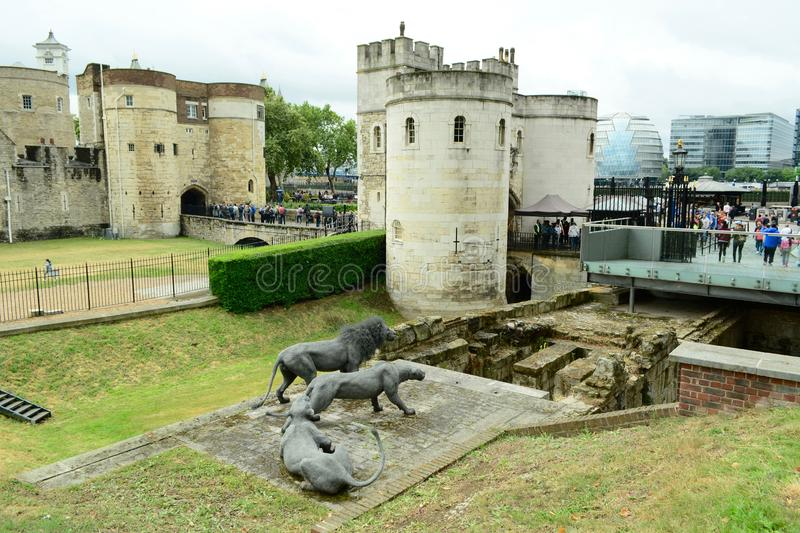 London, UK, July 2019. Lions on guard - wire sculptures by Kendra Haste. The old gate to the Tower of London. The Royal Menagerie is first referenced during the royalty free stock images