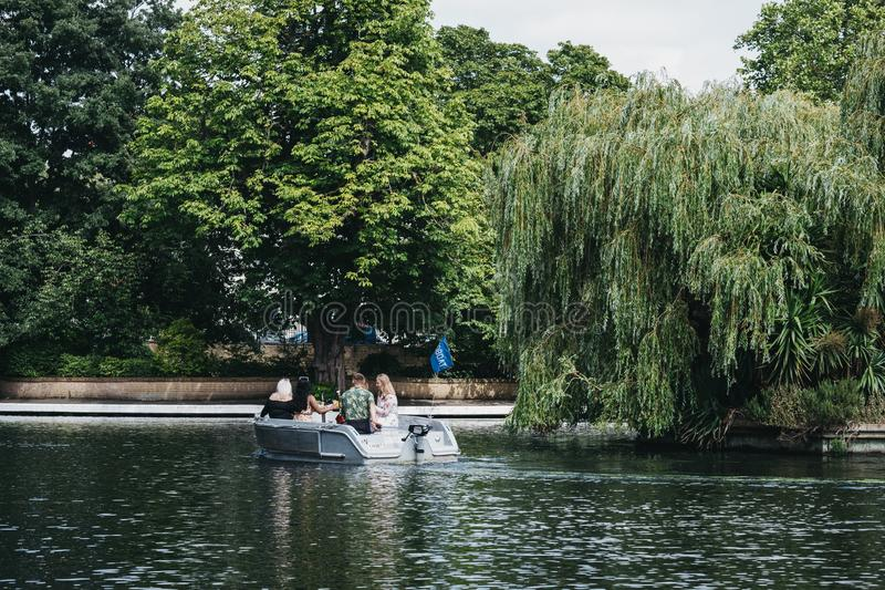 People having a picnic on a boat on Regents Canal in Little Venice, London, UK. London, UK - July 18, 2019: People having a picnic on a boat on Regents Canal in stock photography