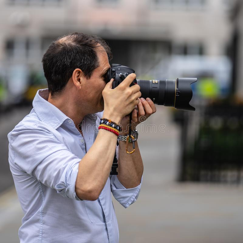 London, UK, July 14, 2019. Photographer taking pictures of sporty models near Polo Ralph Lauren shop. Free public event Regent. Street stock image