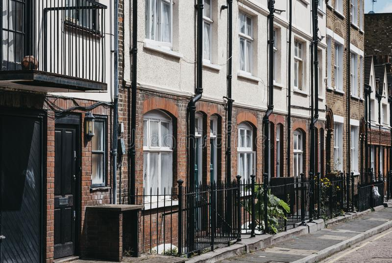 Row of traditional English houses on a residential street in Marylebone, London, UK stock photography