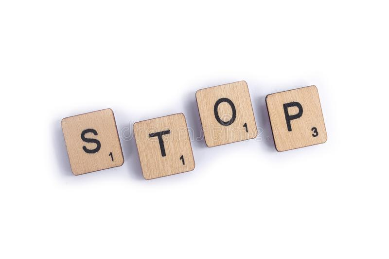 The word STOP. LONDON, UK - JULY 7TH 2018: The word STOP, spelt with wooden letter Scrabble tiles, on 7th July 2018 royalty free stock photo