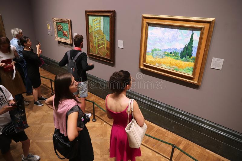 Van Gogh. LONDON, UK - JULY 12, 2019: Tourists admire Van Gogh painting in National Gallery in London. It is the 3rd most visited museum in the UK with 5.7 royalty free stock photography